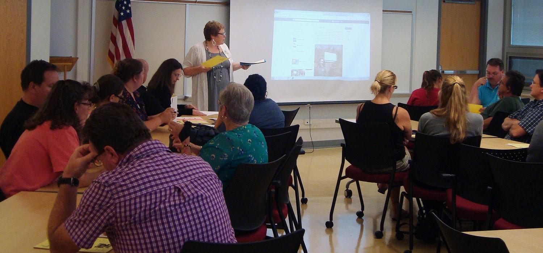 Parents and seniors listen closely to staff member Tara Houdeshell at Senior Info Night 2016