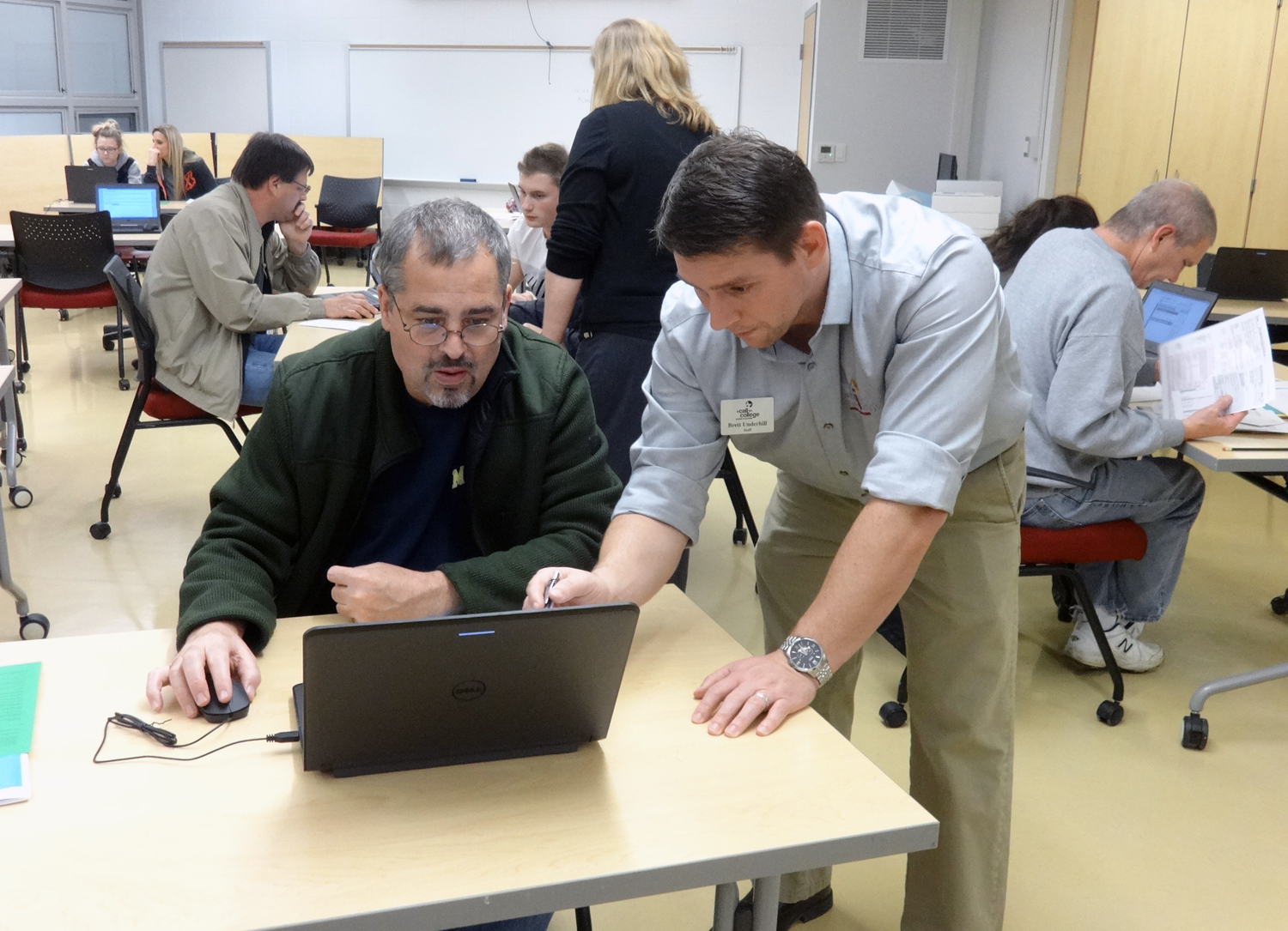 Mr. Underhill, who LOVES the FAFSA, helps a father with his submission