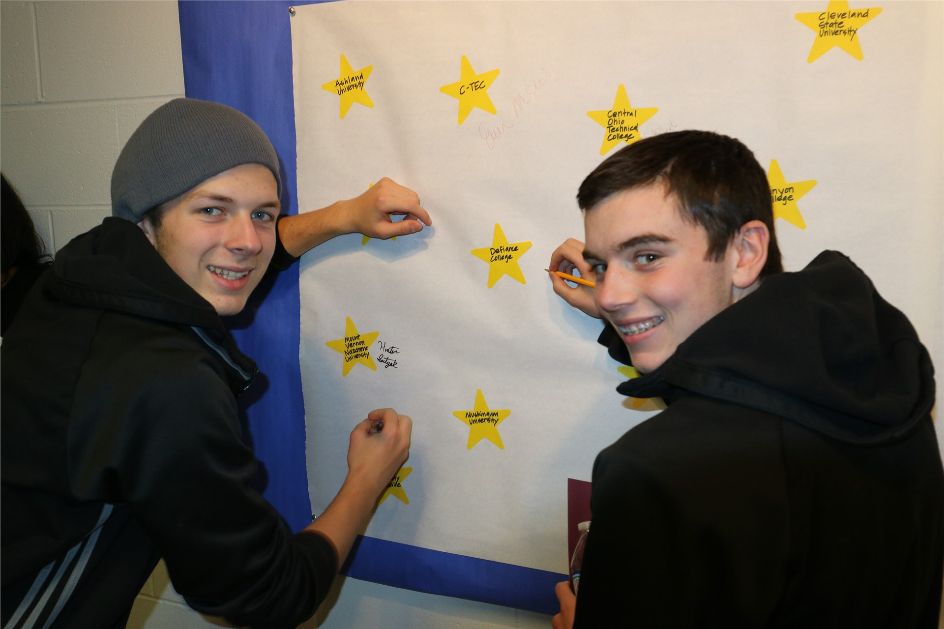 "Last stop, signing the ""I applied to THIS college"" Blitz Wall -- great job you two!"