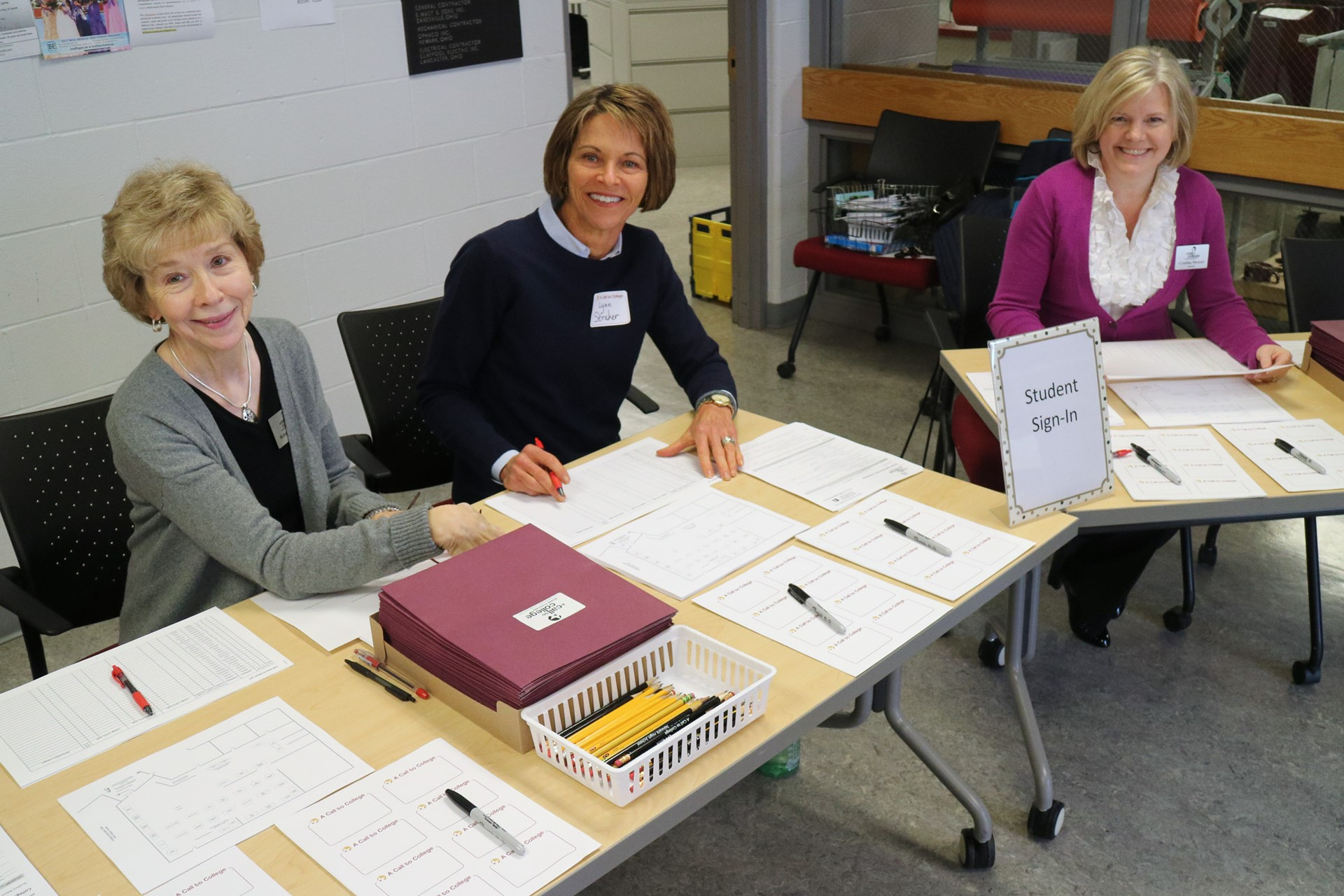 3 wonderful volunteers ready to go at the freshly cleaned check-in table