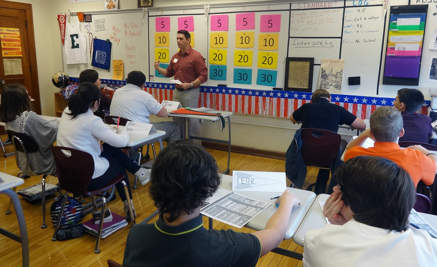 Wilson 8th graders dive into the 3 C's (College, Careers & Cash) with Mr. Underhill